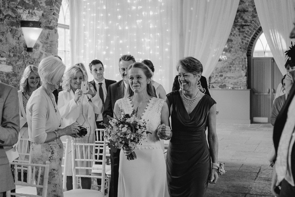 brides mother walks her up the aisle