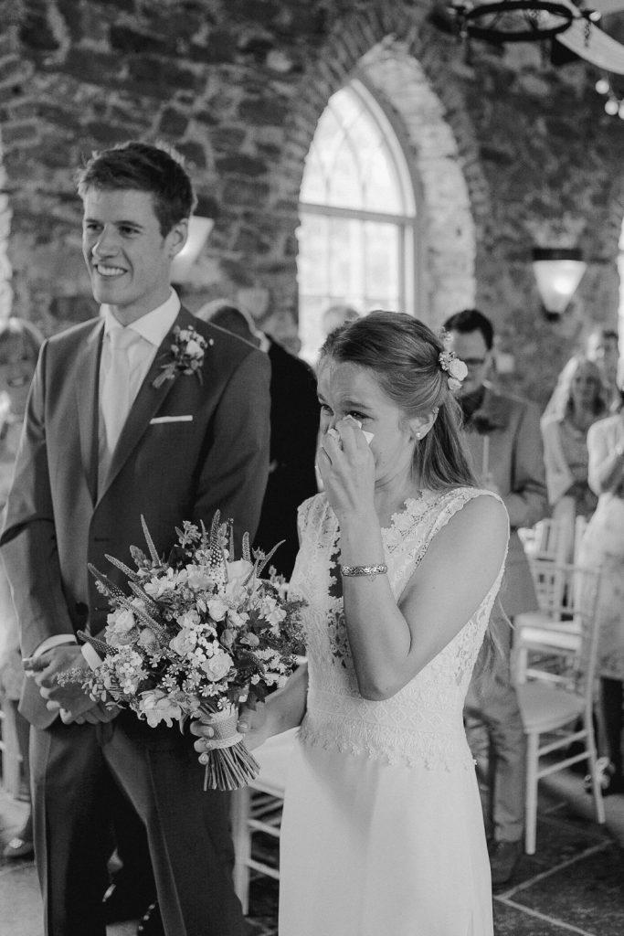 bride wipes tears away