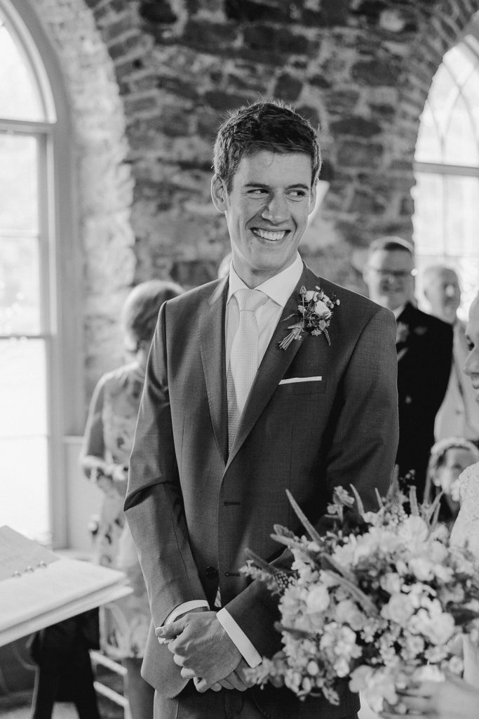 groom smiling to his bride