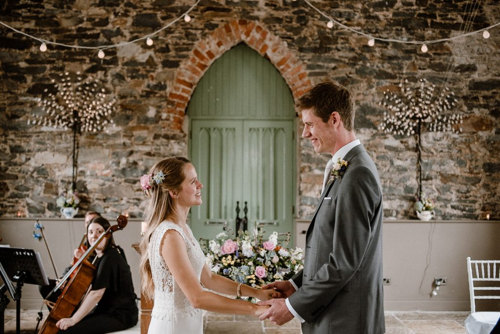 bride and groom make their vows