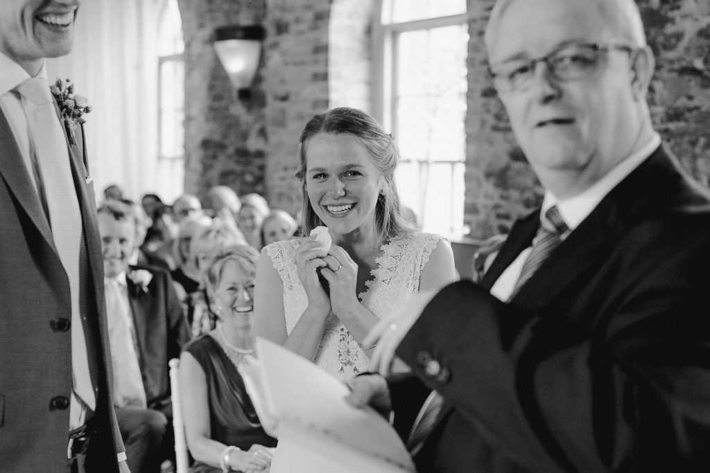 bride is smiling and crying