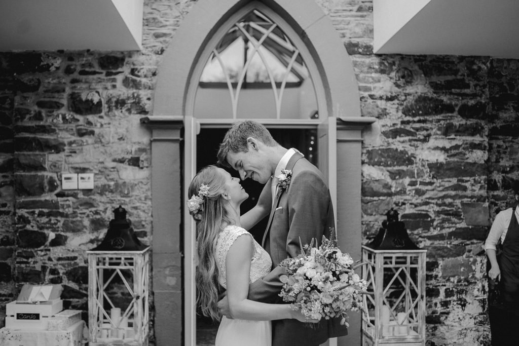 bride and groom stop for a kiss