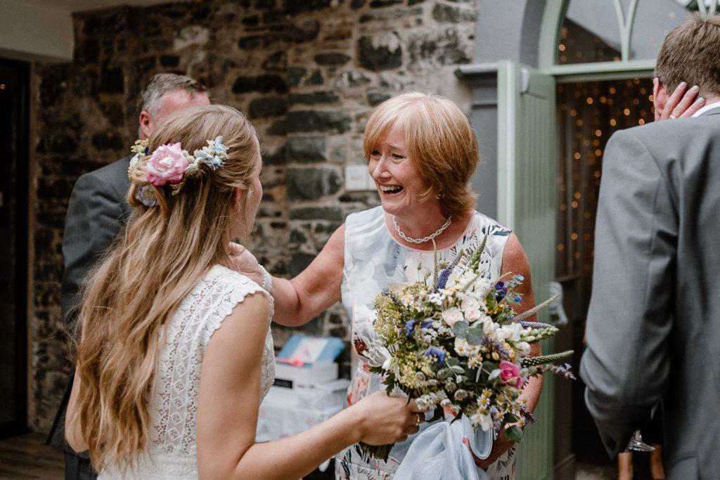 grooms mother congratulates the bride