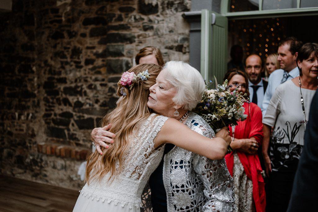 bride hugs her grandmother
