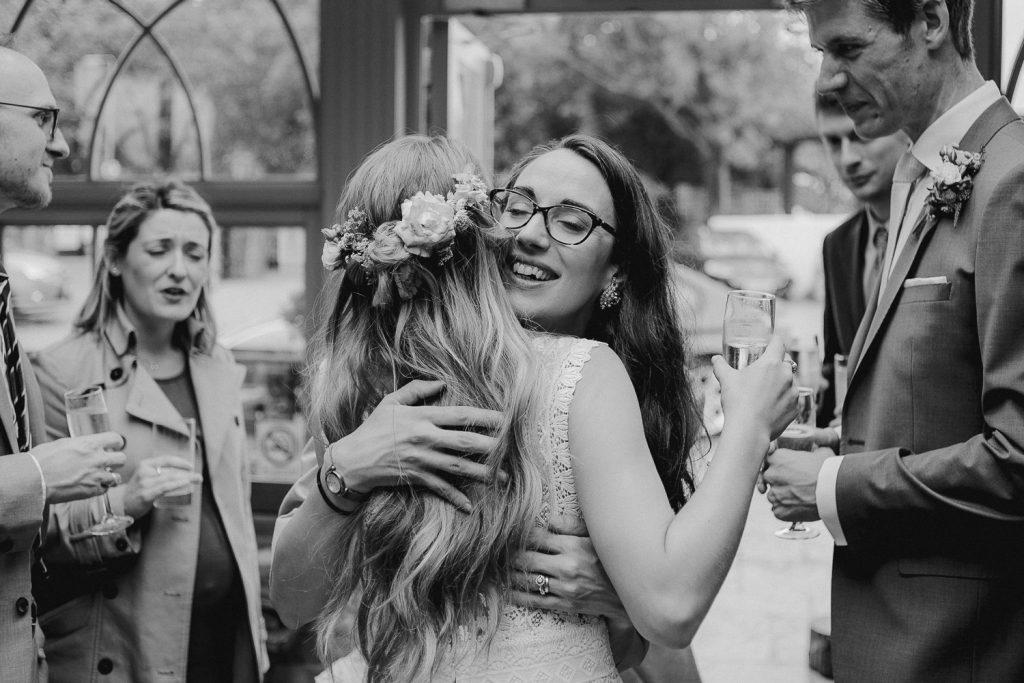 wedding guest hugs the bride
