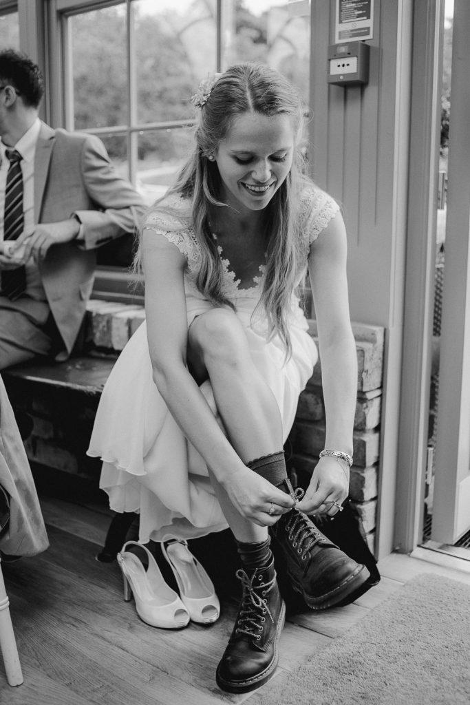 bride laces up her dm boots