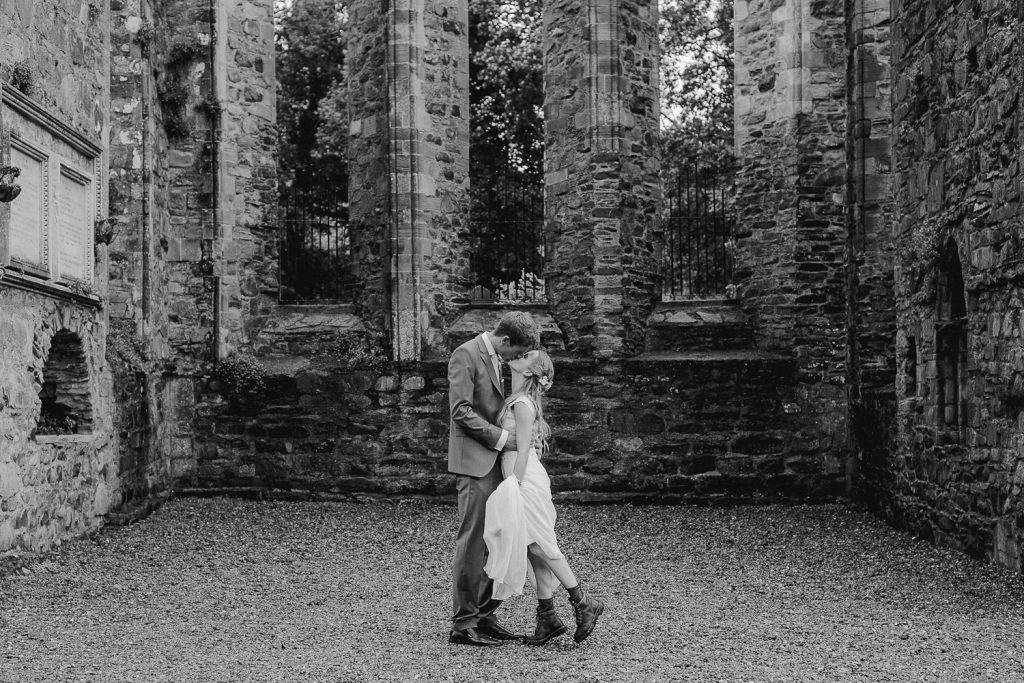 bride and groom in old ruins