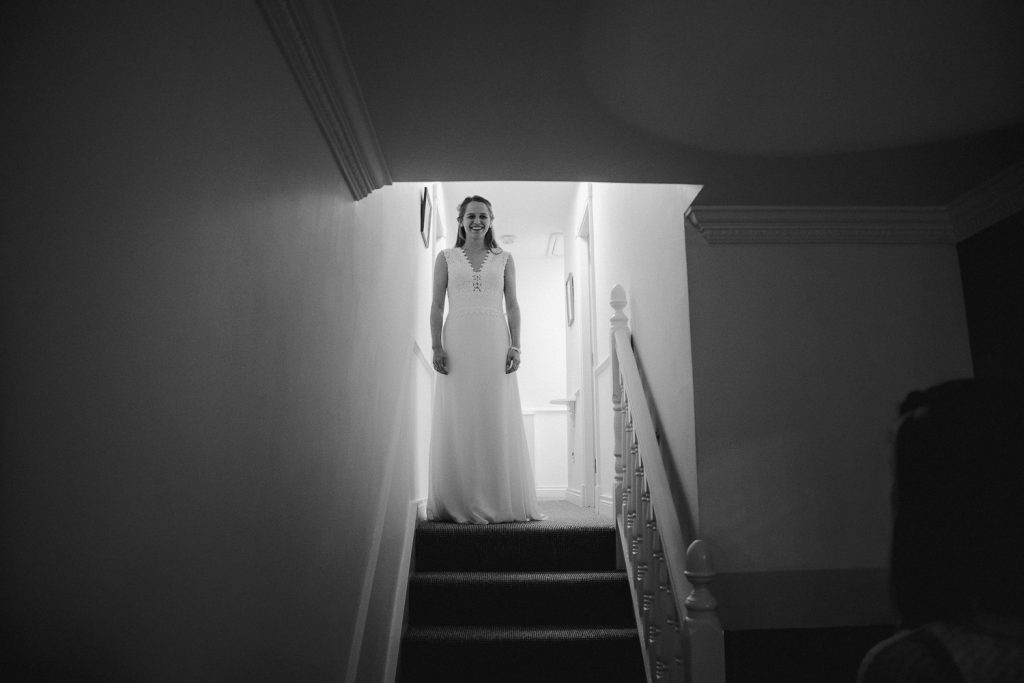 bride getting ready to walk down stairs