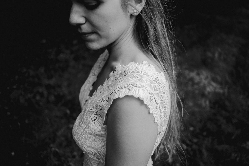 close up of brides lace dress