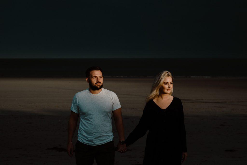 couple in beautiful light on beach
