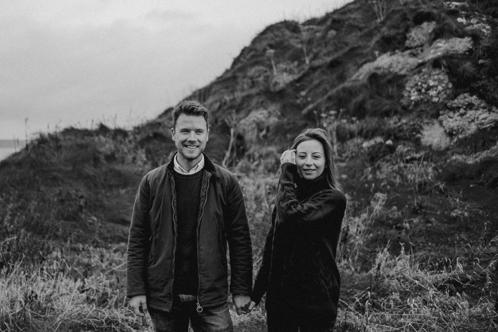 couple shoot elopement on causeway coast. Standing holding hands