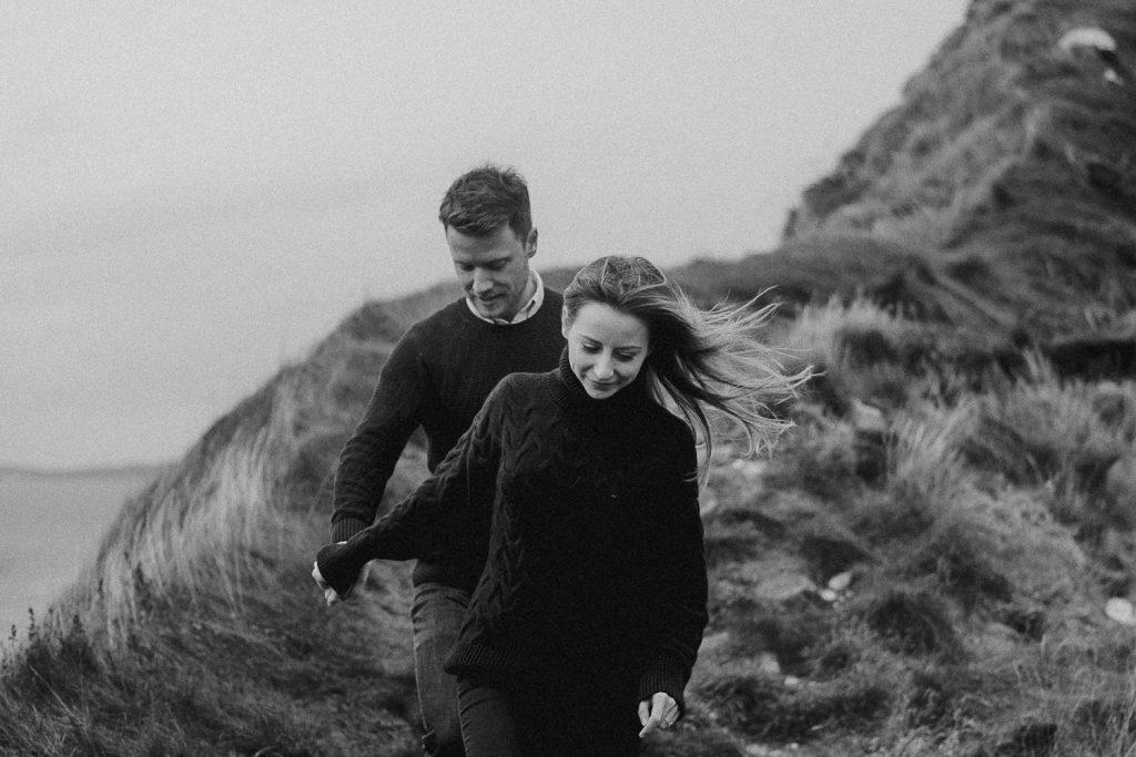 couple walking down wild landscape