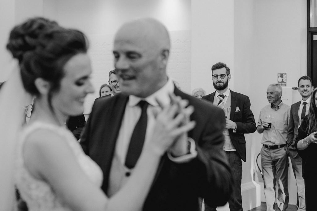 groom watched father daughter dance