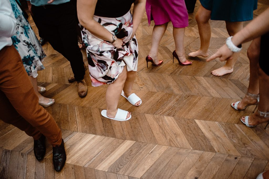 someone on dance floor wearing slippers