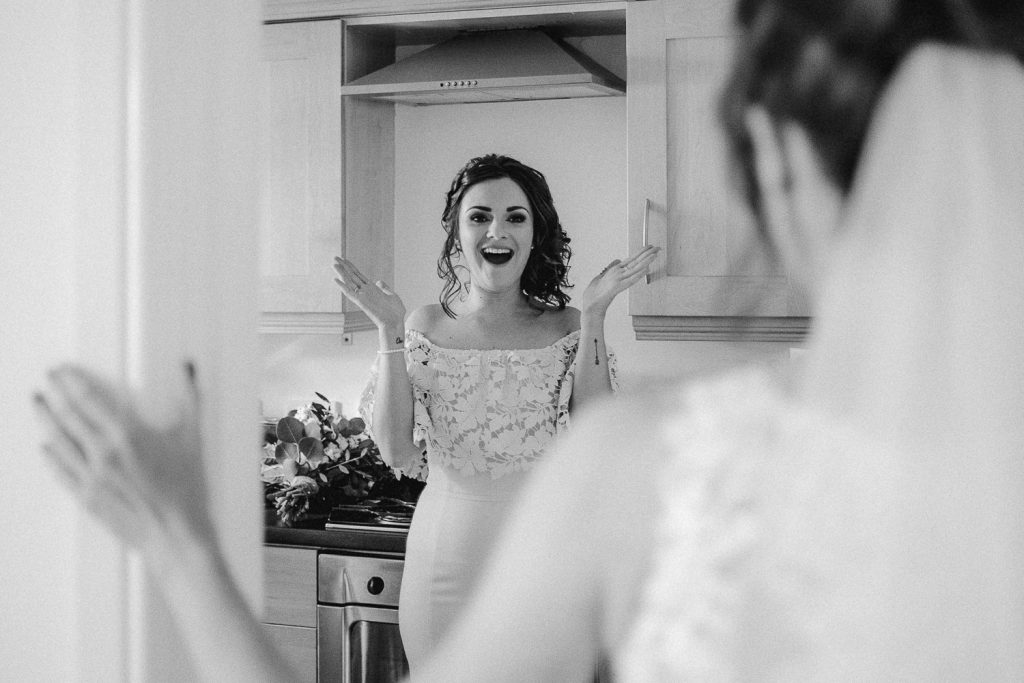 bridesmaid excited face when she sees bride in dress.