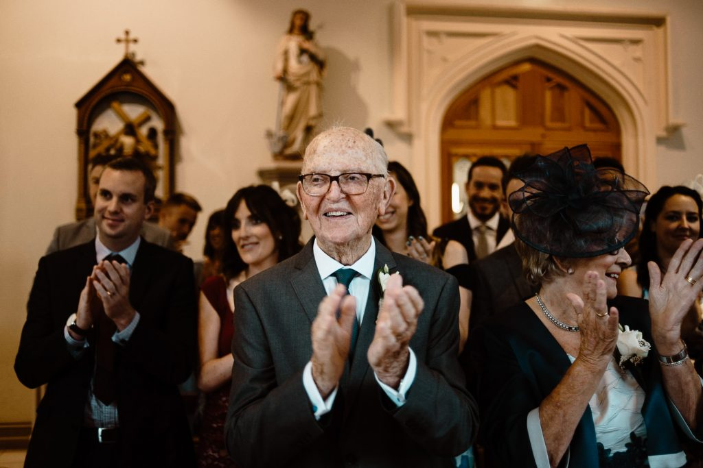 grandfather clapping in celebration at wedding