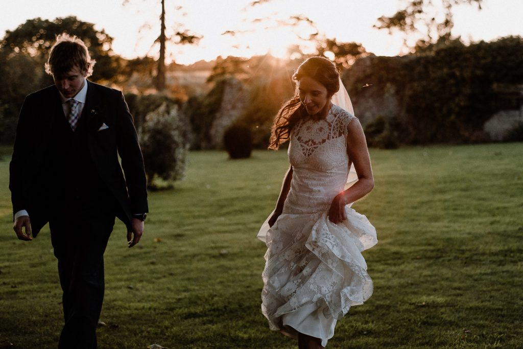 bride and groom running back in Gracehall wedding