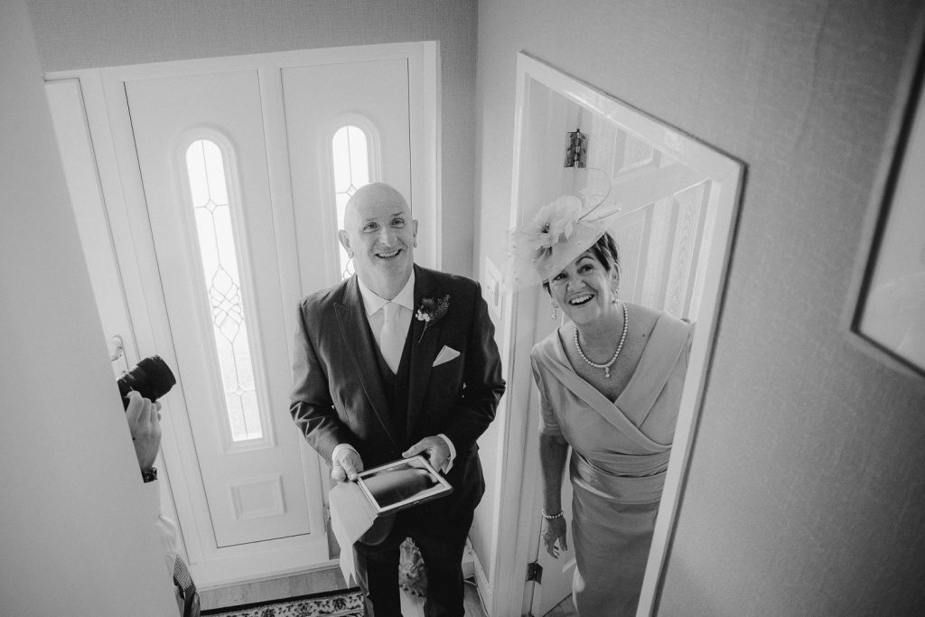 brides parents looking up stairs