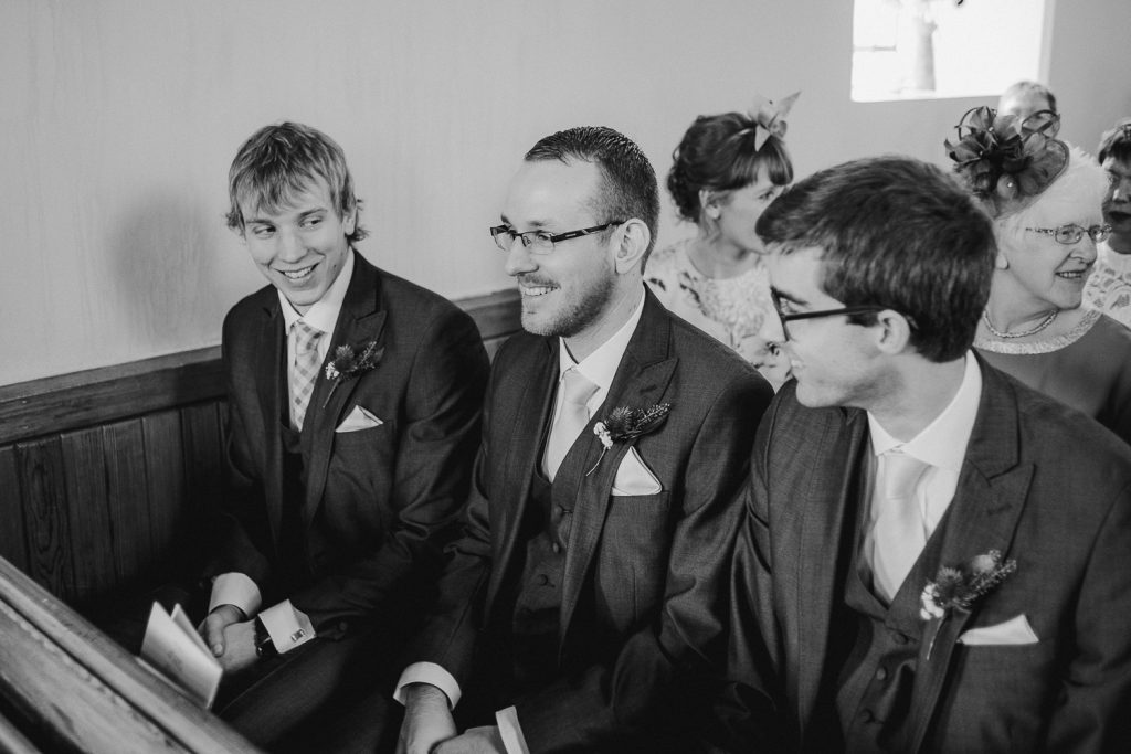 groom in church with friends