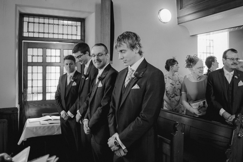groom waiting at the alter