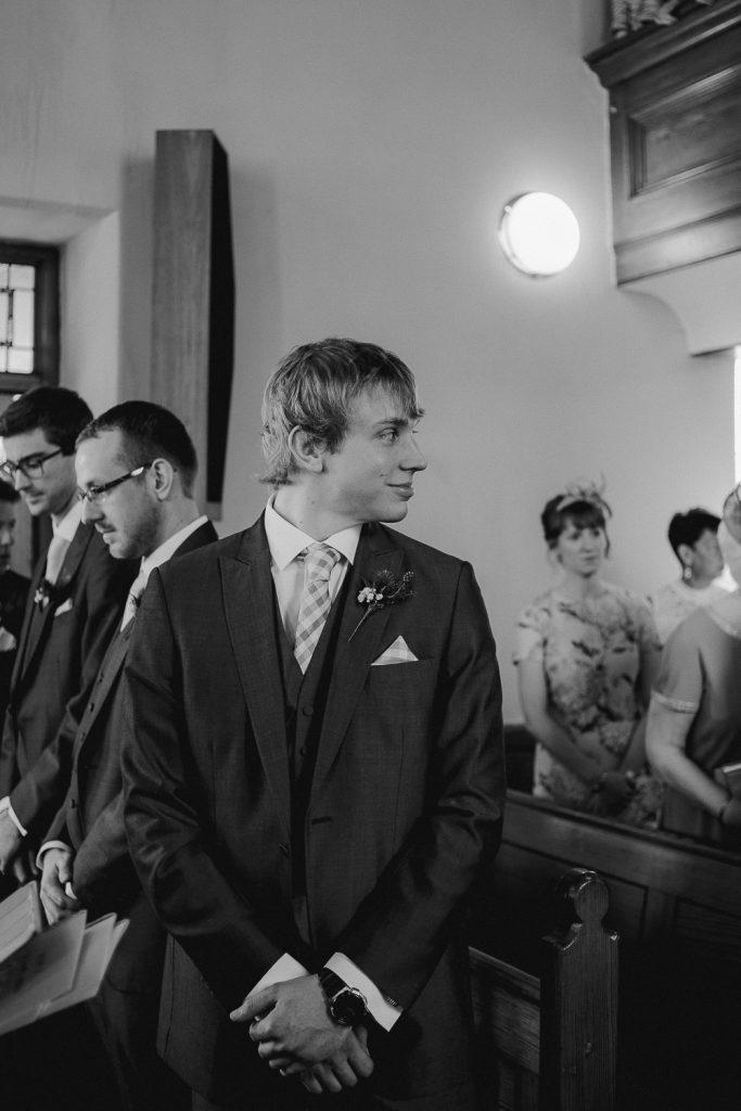groom looking back at bride