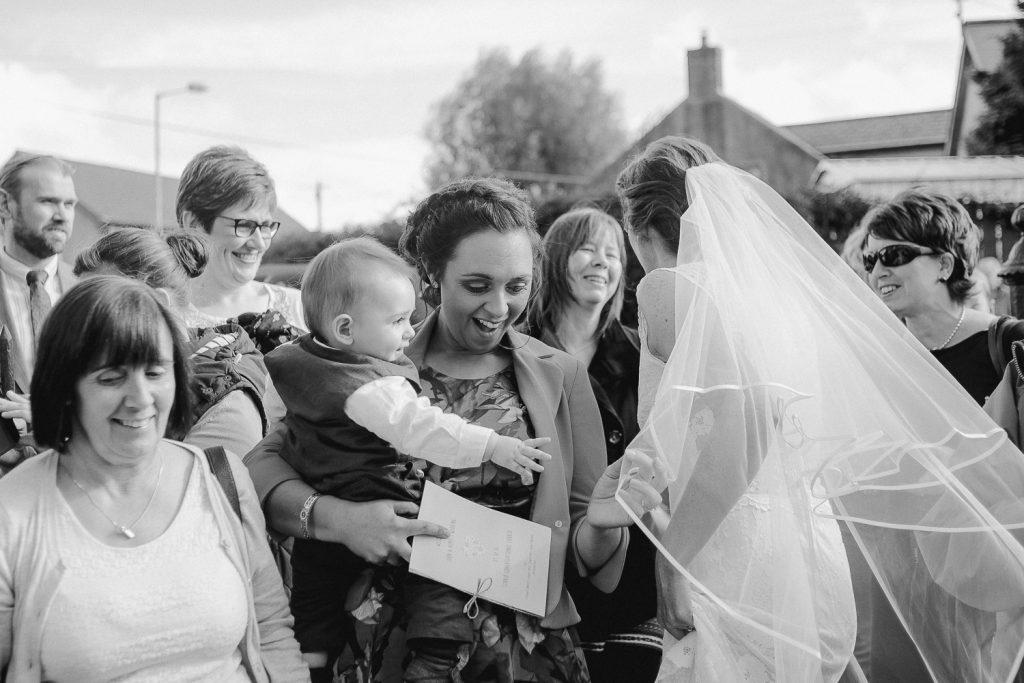 baby sees bride