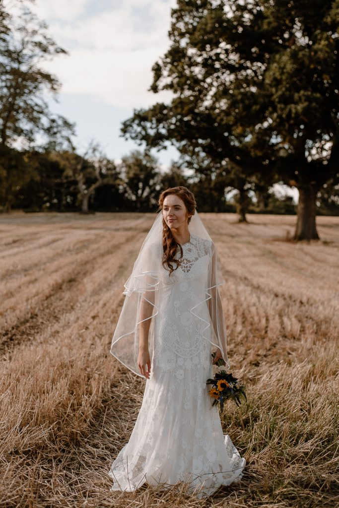 Gracehall wedding. Bride in wheat field