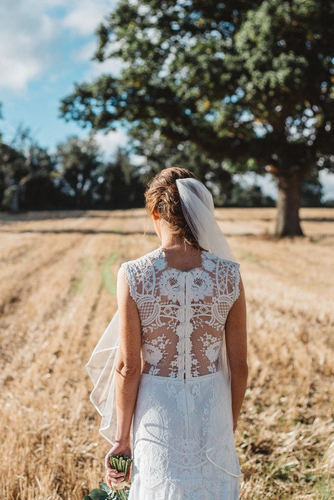Close up of brides wedding dress. Gracehall wedding