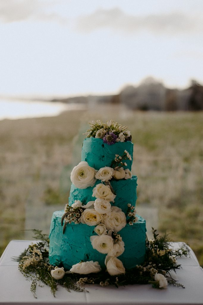 blue wedding cake with white flowers