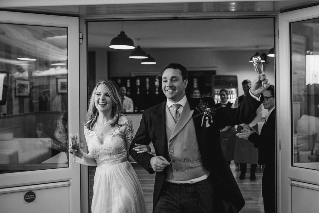 bride and groom walk into the the crannagh coleraine