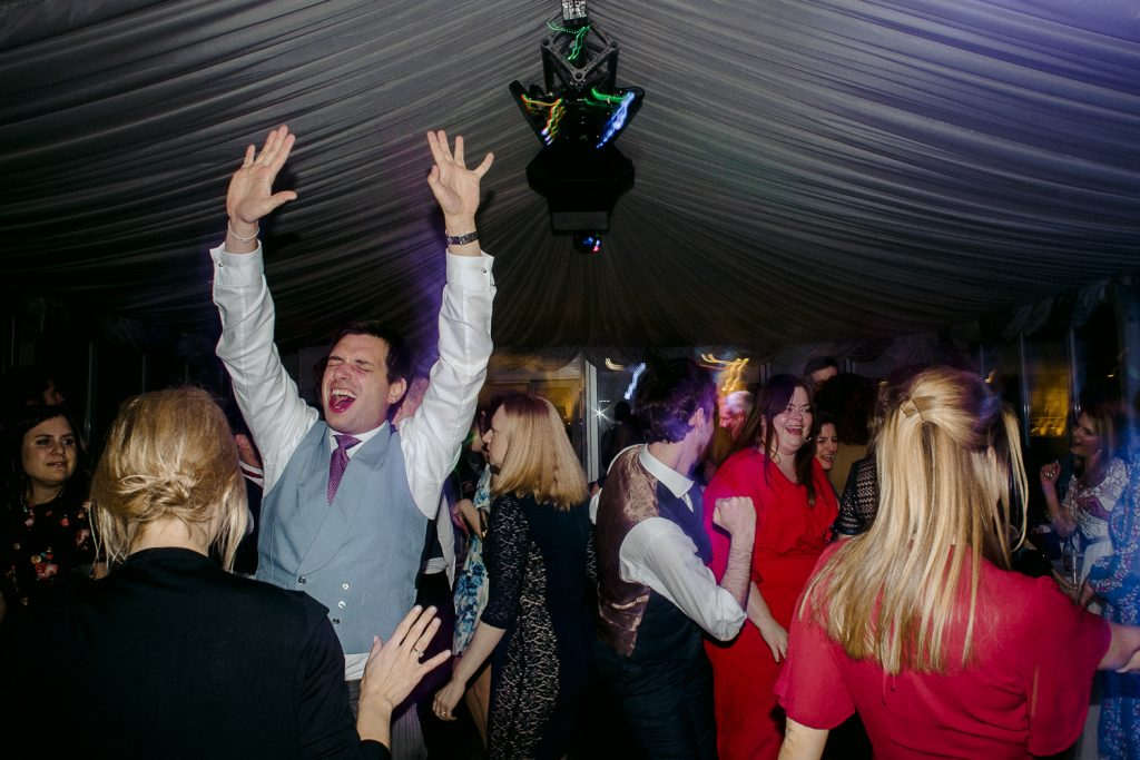 wedding guests cheering and dancing