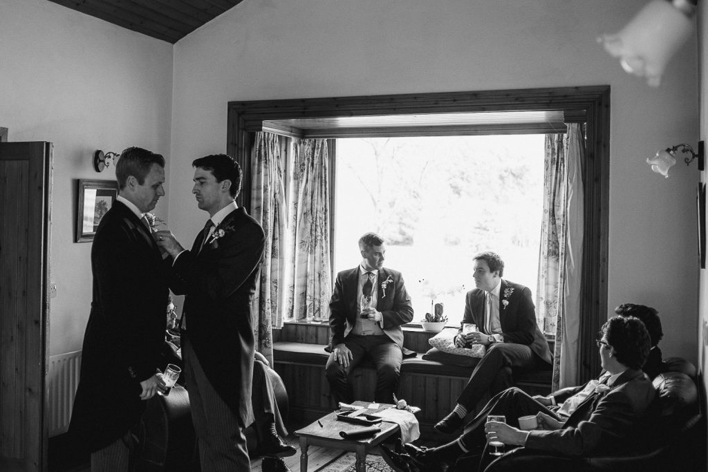 groomsmen sitting around a room chatting