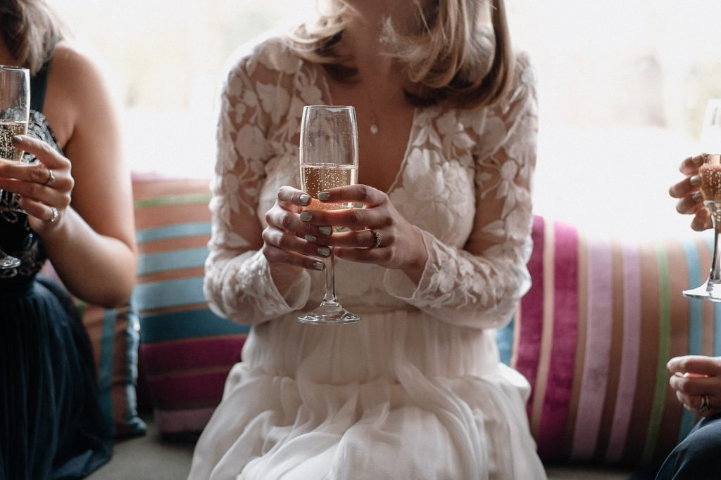 close up of bride holding champagne