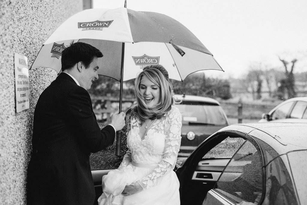 bride getting out of car, very windy