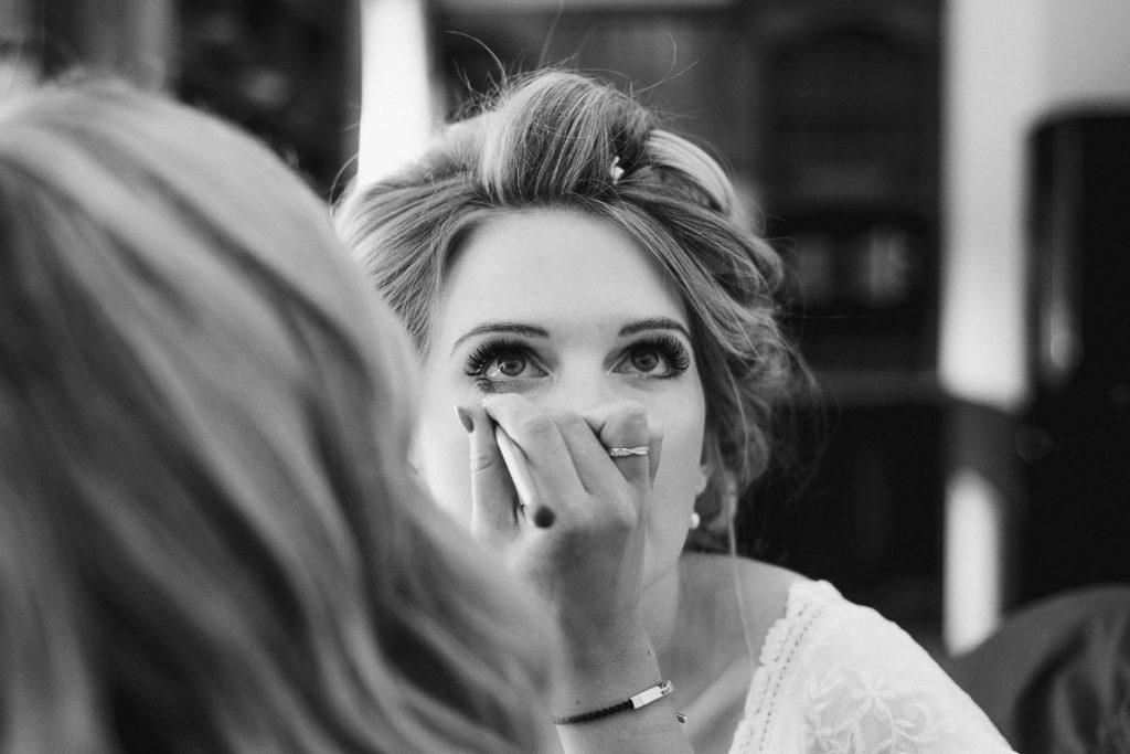 bride getting eye make up on