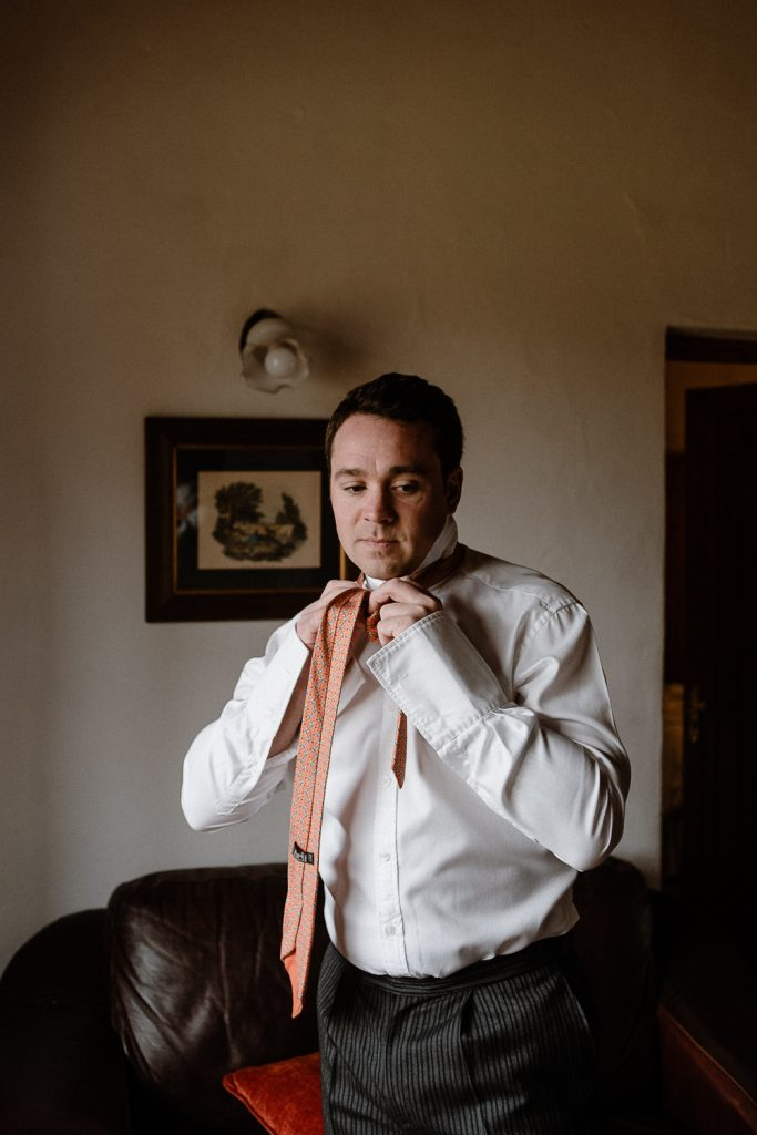 groom doing tie