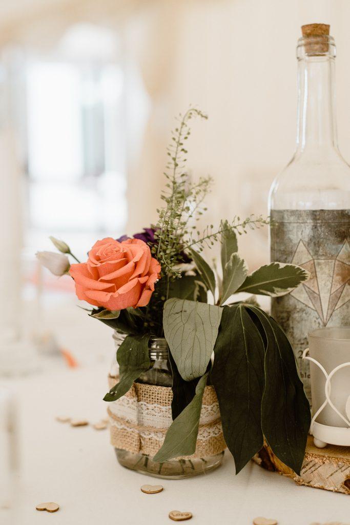 orange rose in a jar