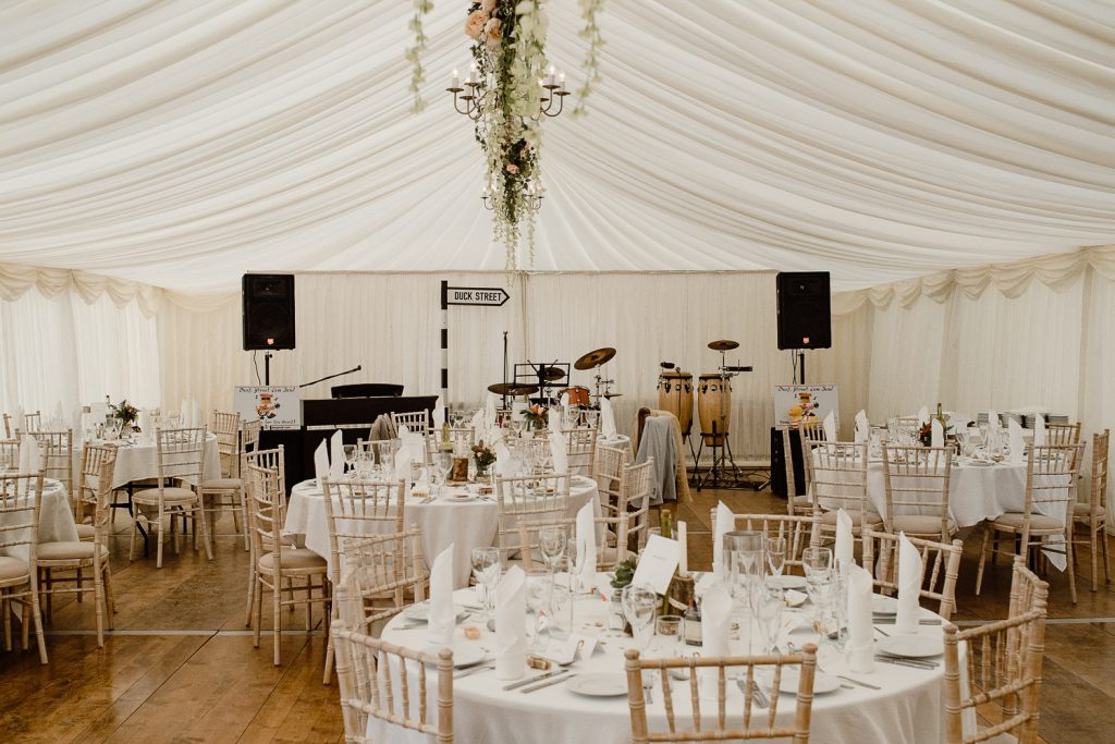 marquee decorated with tables and chairs for wedding