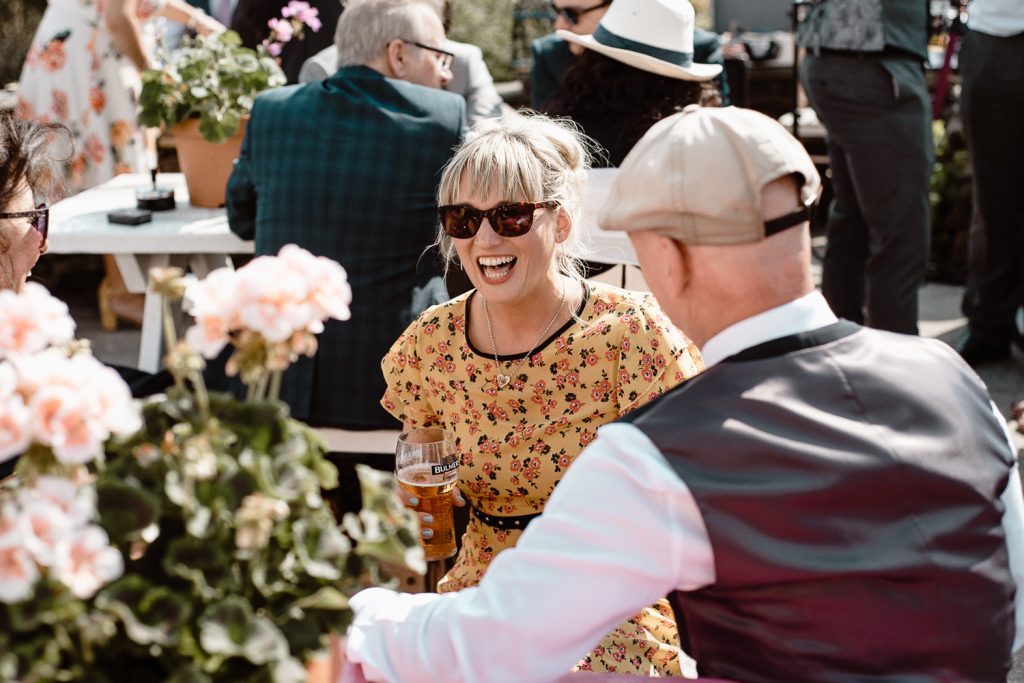 woman at wedding in glasses laughing