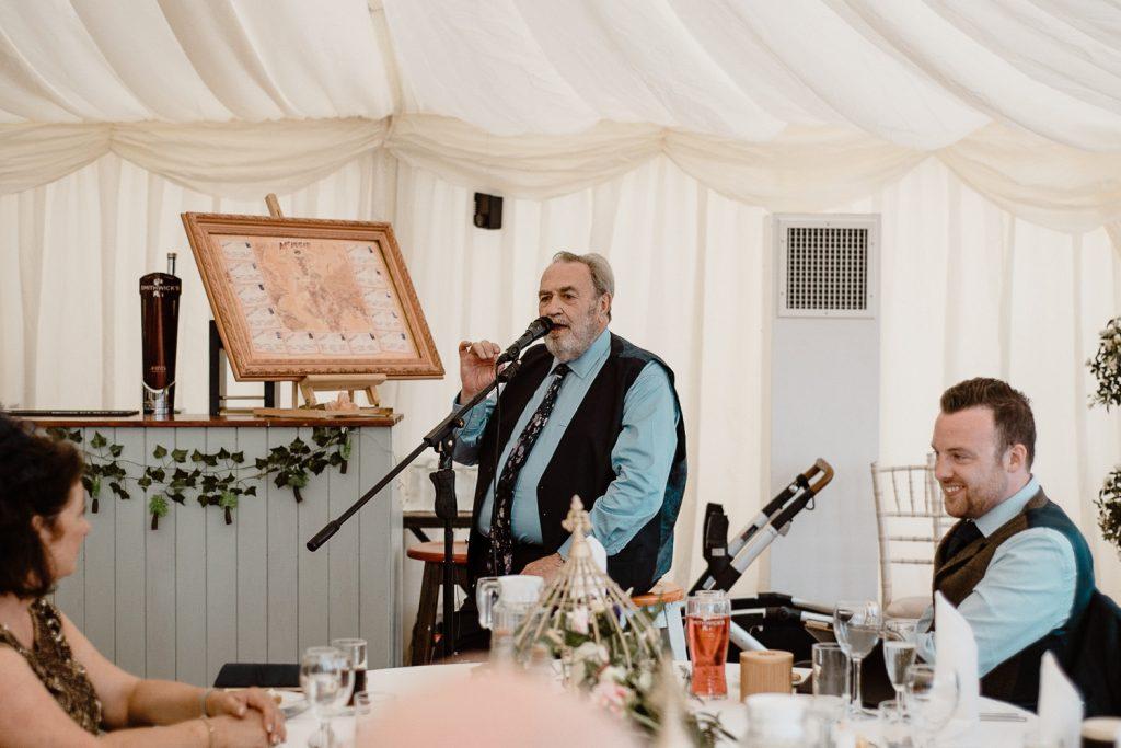 man in tie giving speech