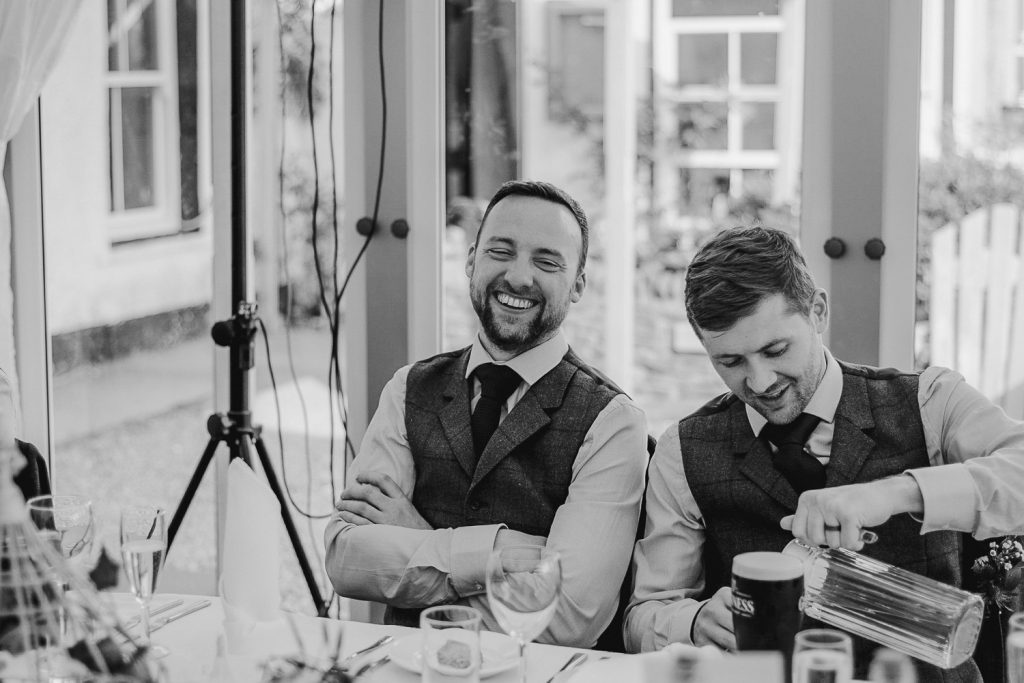man in sie and waistcoat laughing