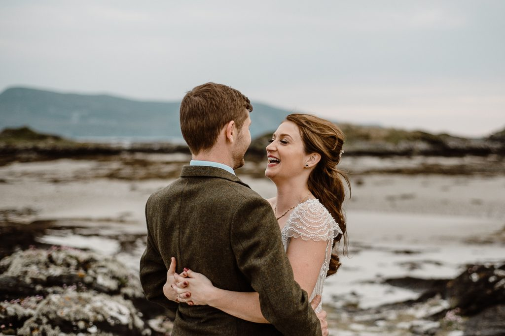 bride laughing and hugging groom