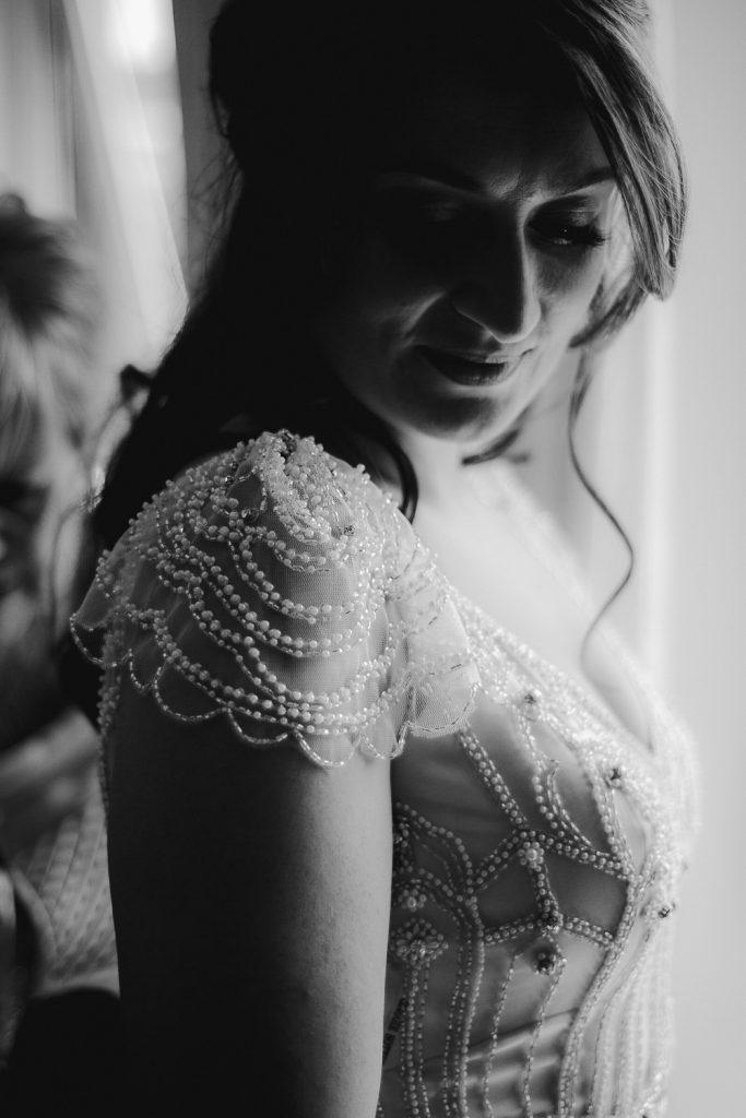 close up of detail on brides dress