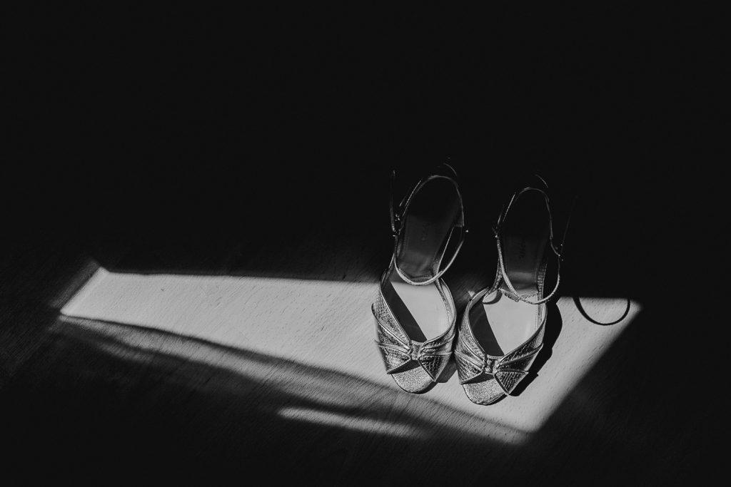 wedding shoes in hard sunlight