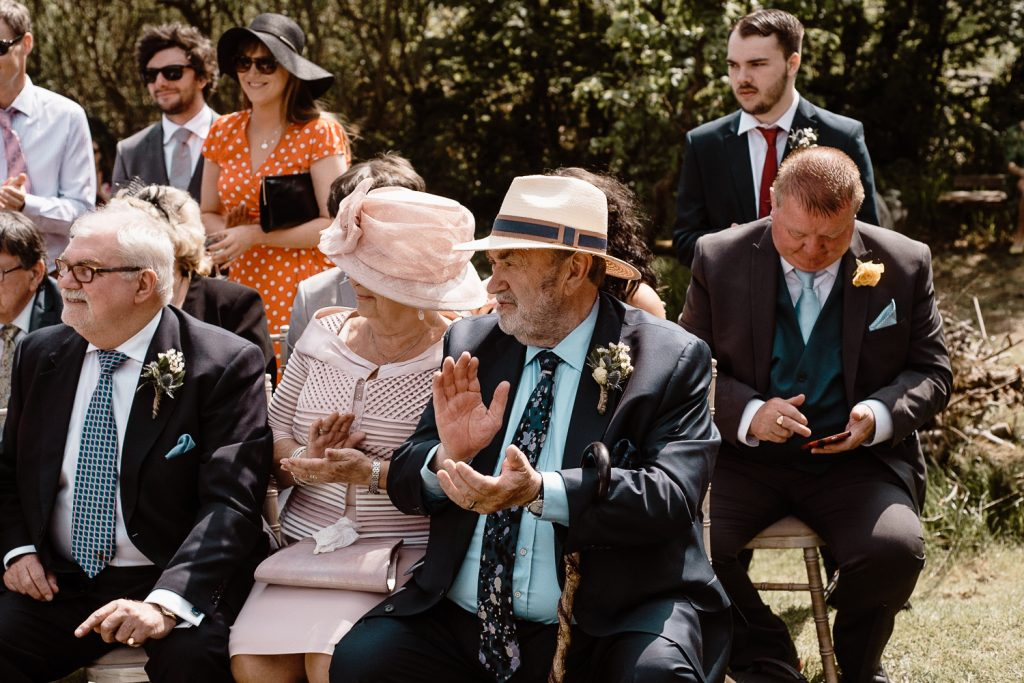 father of the bride clapping