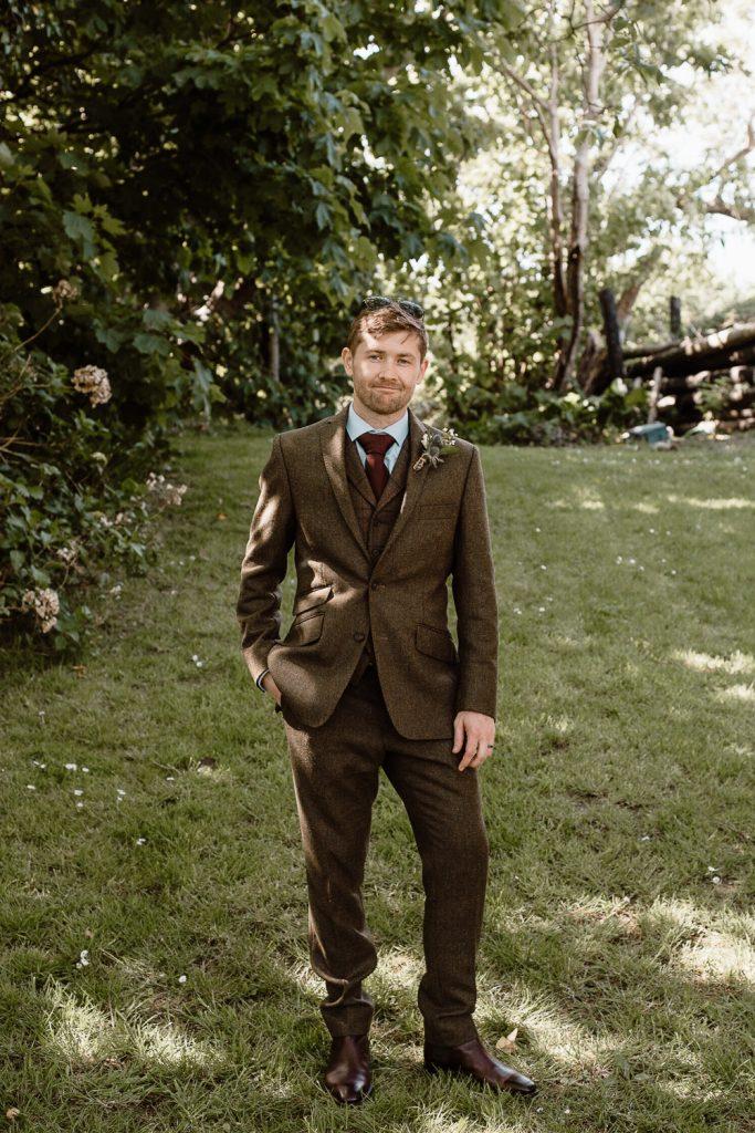 full length of groom standing