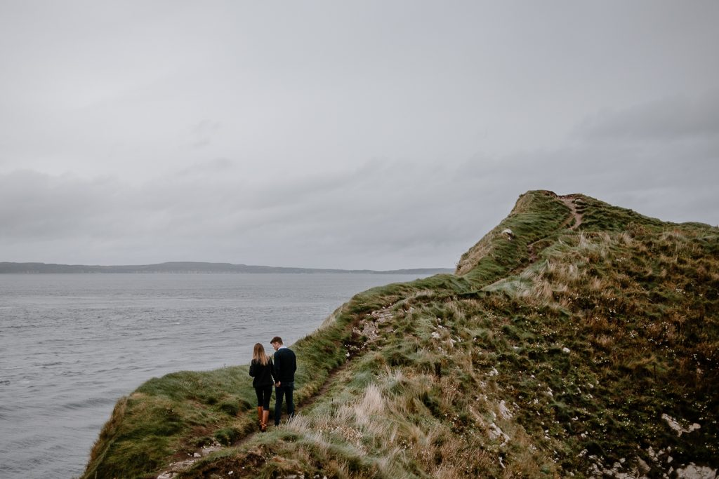 couple walking hand in hand up Kinbane head