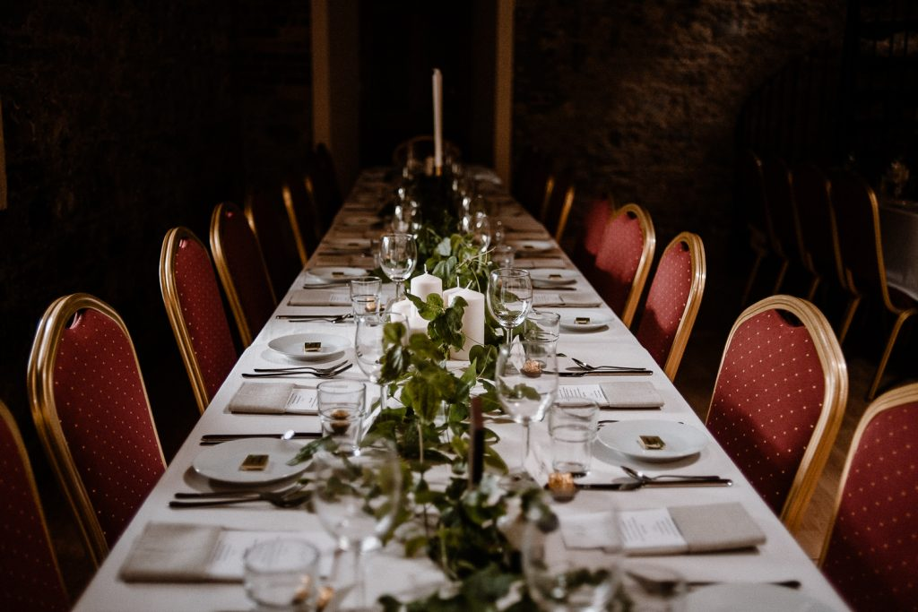 reception dinner table decorated with greenery