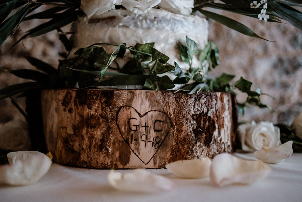 bride and grooms initials carved on tree trunk