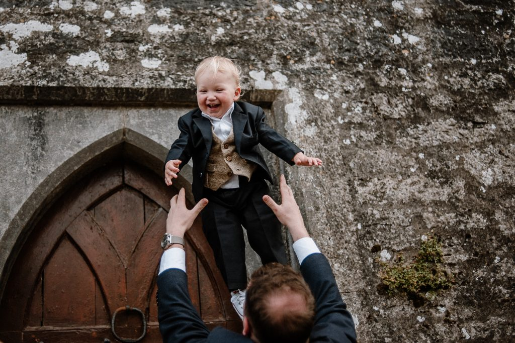 groom throwing his son in the air
